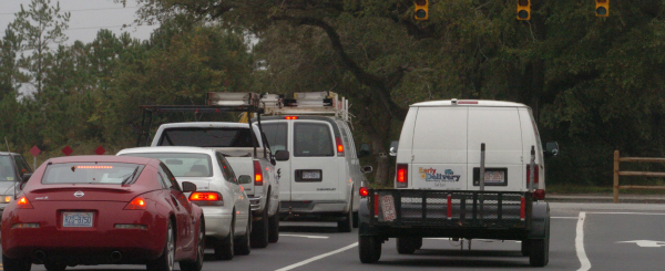 Cars wait for the light to change at Middle Sound Loop Road and Market Strret Monday Nov. 2, 2009. The light is the longest red light in the city, said Don Bennett, the city's traffic engineering manager. Its entire cycle is 304 seconds. Photo BY KEN BLEVINS / WILMINGTON STAR NEWS