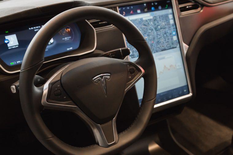 54609245 - milan, italy - march 31, 2016: interior of tesla model s 90d car. tesla motors  is an american company that designs, manufactures, and sells cutting edge electric cars.